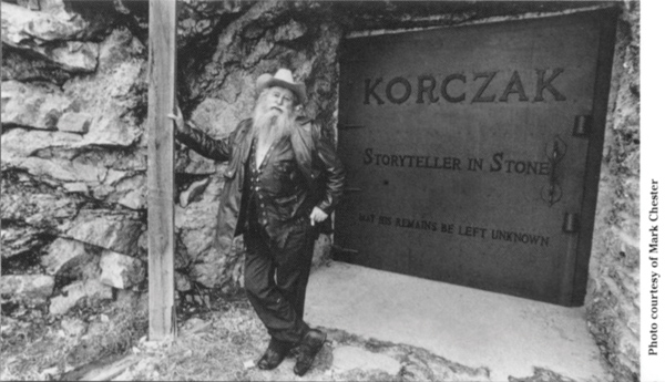 Korczak standing by the tomb