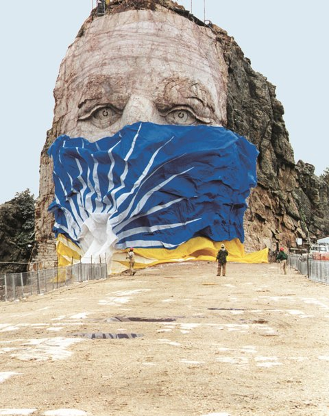 Flag coming off of the Crazy Horse Memorial face