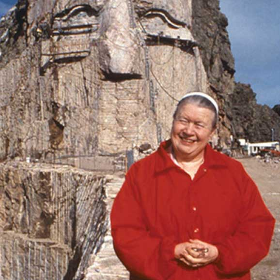 Ruth standing with Crazy Horse Memorial face